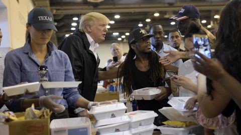 President Donald Trump and Melania Trump pass out food and meet people impacted by Hurricane Harvey during a visit to the NRG Center in Houston on September 2, 2017.