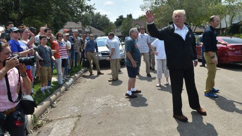 President Donald Trump visit a neighborhood in Houston while touring areas affected by Hurricane Harvey on September 2.
