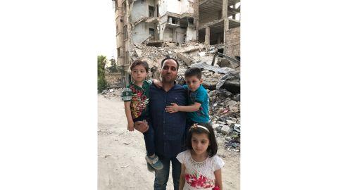 Mohammed Kheir Daqneesh with his three children.