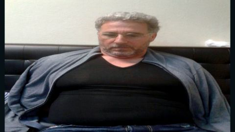 In this photo taken on Sunday, Sept. 3, 2017, a man identified by Italian Police as longtime fugitive Rocco Morabito looks down after being arrested in a Montevideo hotel, Uruguay. Italian authorities say a top 'ndrangheta crime syndicate boss, on the run since 1994, has been arrested in Uruguay where he had been living under a false name and with a forged Brazilian passport. Reggio Calabria Chief Prosecutor Federico Cafiero de Raho said Monday longtime fugitive Rocco Morabito played a big role in cocaine trafficking between South America and Milan, a distribution point for the drug to be sold elsewhere. The Calabria-based 'ndrangheta is one of the world's biggest cocaine traffickers. (Italian Police via AP)
