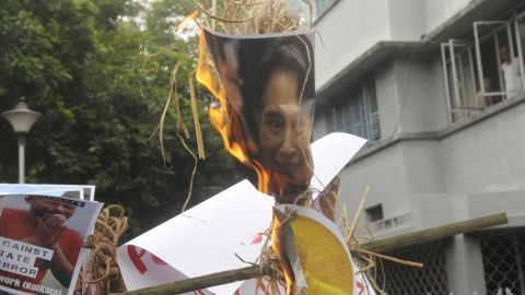 KOLKATA, INDIA - SEPTEMBER 4: Students of Film Studies, Jadavpur University enact a street play on genocide of Rohingya Muslim people of Myanmar during a protest rally in front of Myanmar Consulate office on September 4, 2017 in Kolkata, India. They also demanded the resignation of Noble Peace Laureate Myanmar's Foreign Minister Aung San Suu Kyi and brunt her effigy. (Photo by Samir Jana/Hindustan Times via Getty Images)