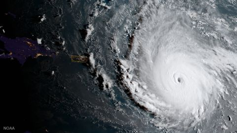 In this geocolor image captured by GOES-16  and released by the National Oceanic and Atmospheric Administration (NOAA), Hurricane Irma, a potentially catastrophic category 5 hurricane, moves westward, Tuesday morning, Sept. 5, 2017, in the Atlantic Ocean toward the Leeward Islands. This image was captured as daylight moves into the area, right, with nighttime features on the left side of the image. Hurricane Irma grew into a dangerous Category 5 storm, the most powerful seen in the Atlantic in over a decade, and roared toward islands in the northeast Caribbean Tuesday on a path that could eventually take it to the United States. (NOAA via AP)