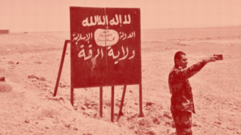 A picture taken on July 9, 2017 shows a Syrian regime forces member taking a selfie with an Islamic State (IS) group billboard at the Ithraya-Rasafa highway in the countryside of the city of Raqa. On June 30, 2017 a  military source, quoted by Syrian state news agency SANA, confirmed that the Islamic State (IS) group had pulled out of territory along the Ithraya-Rasafa highway.  / AFP PHOTO / George OURFALIAN        (Photo credit should read GEORGE OURFALIAN/AFP/Getty Images)