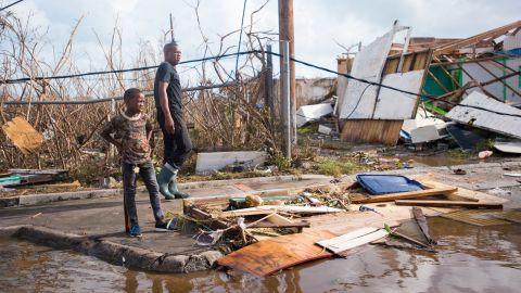 People survey damage in Marigot on September 7.