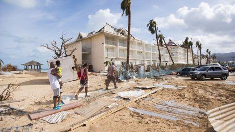 People walk through damage in Marigot, St. Martin, on September 7.