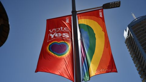 """A """"Vote Yes"""" banner in support of same sex-marriage hangs on a street in Sydney on September 5, 2017.  Same-sex marriage advocates launched legal action in Australia's highest court on September 5, 2017 against a controversial government plan for a postal vote on the issue, calling it divisive and harmful. / AFP PHOTO / PETER PARKS        (Photo credit should read PETER PARKS/AFP/Getty Images)"""