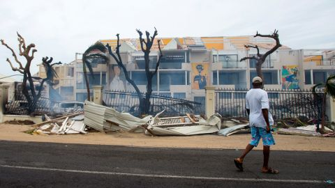 A man walks past damaged buildings in St. Martin on September 6.