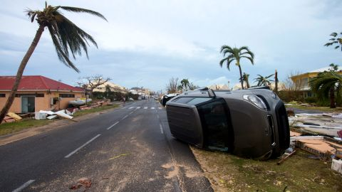 A car is flipped onto its side in Marigot.
