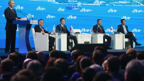 """Russian President Vladimir Putin, left, speaks as South Korea's President Moon Jae-in, third from left, Mongolia's President Khaltmaagiin Battulga, second from right, and Japan's Prime Minister Shinzo Abe, right, listen during a plenary session titled """"The Russian Far East: Creating a New Reality"""" at the Eastern Economic Forum in Vladivostok, Russia, Thursday, Sept. 7, 2017. Putin says he believes U.S. President Donald Trump's administration is willing to defuse tensions on the Korean Peninsula. (Vladimir Smirnov/TASS News Agency Pool Photo via AP)"""