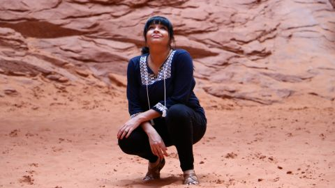 Through an Instagram account, Ambreen Tariq -- here at Arches National Park in Utah -- explores what it means to be a person of color in the outdoors.