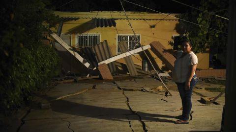 A woman gestures toward her earthquake-damaged home in Coatzacoalcos, Mexico.