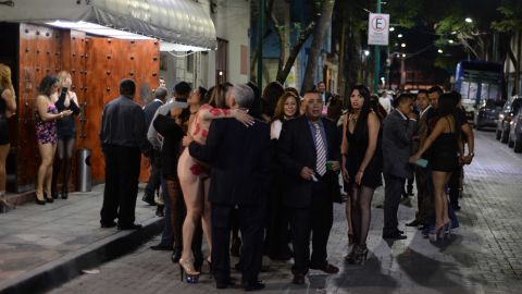 People gather outside a Mexico City nightclub after the quake.