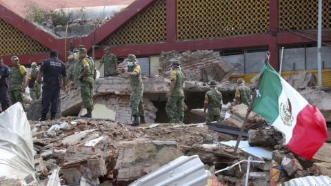 """Soldiers remove debris from a partially collapsed municipal building in Juchitan, Mexico, on Friday, September 8. <a href=""""http://www.cnn.com/2017/09/08/americas/earthquake-hits-off-the-coast-of-southern-mexico/index.html"""" target=""""_blank"""">A magnitude-8.1 earthquake</a> was registered the night before off Mexico's southern coast. It is the strongest quake to hit the country in 100 years, according to President Enrique Peña Nieto."""