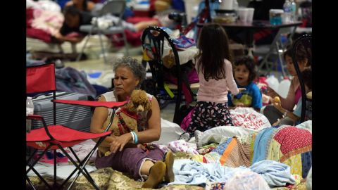 """People sit in the Miami-Dade County Fair Expo Center as Irma approached Miami on Saturday, September 9. <a href=""""http://www.cnn.com/2017/09/07/americas/gallery/hurricane-irma-caribbean/index.html"""">See Hurricane Irma's impact on the Caribbean</a>"""