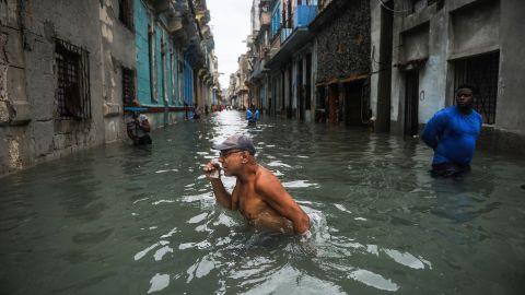 A man wades through a flooded street in Havana on September 10.