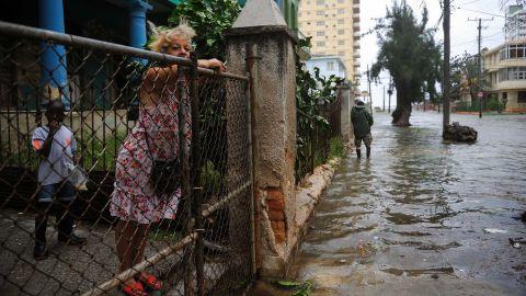 A woman surveys flooding in Havana on September 9.