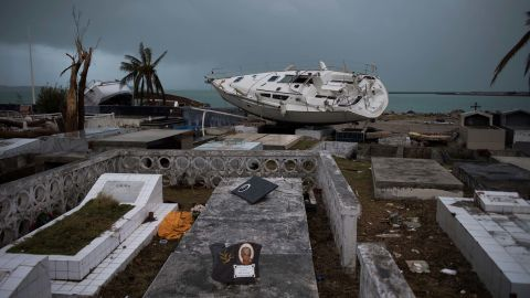 A boat rests in a cemetery after Irma tore through Marigot, St. Martin.