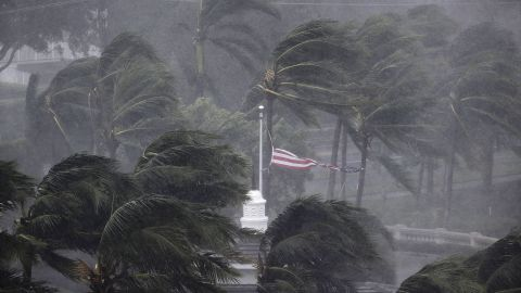 An American flag is torn as Irma passes through Naples on September 10.