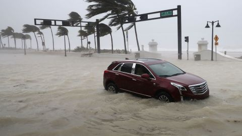 An abandoned car sits in floodwaters during a storm surge in Fort Lauderdale on September 10.