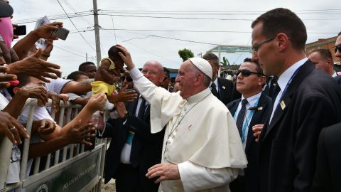 Pope Francis, showing a bruise around his left eye and eyebrow caused by an accidental hit against the popemobile's window glass while visiting the old sector of Cartagena,Colombia, is greeted by faithful on September 10, 2017.Nearly 1.3 million worshippers flocked to a mass by Pope Francis on Saturday in Medellin, the Colombian city known as the stronghold of the late drug lord Pablo Escobar. / AFP PHOTO / Alberto PIZZOLI        (Photo credit should read ALBERTO PIZZOLI/AFP/Getty Images)