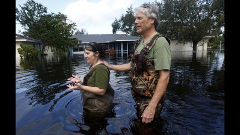 Kelly McClenthen and her boyfriend, Daniel Harrison, walk through floodwaters in Bonita Springs on September 11.