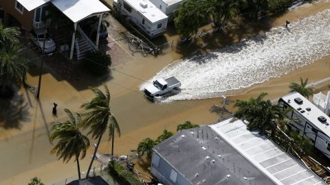 A truck drives through a flooded street in Key Largo on September 11.