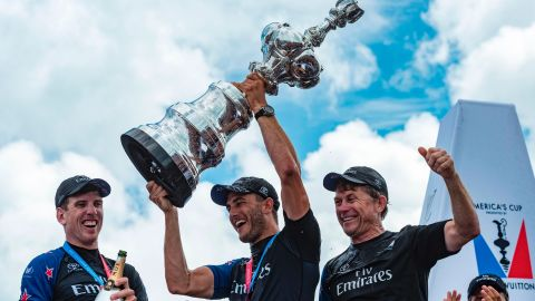 Emirates Team New Zealand helmsman Peter Burling and trimmer Blair Tuke and shore crew manager Sean Regan hoist the America's Cup in the Great Sound during the 35th America's Cup June 26, 2017 in Hamilton, Bermuda. / AFP PHOTO / Chris CAMERON        (Photo credit should read CHRIS CAMERON/AFP/Getty Images)