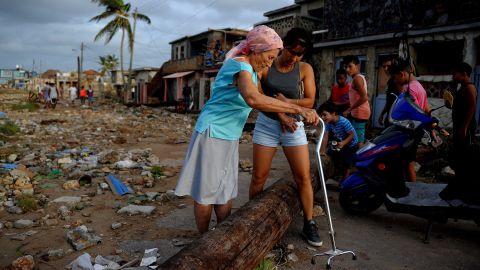 People make their way through debris in the Cojimar neighborhood of Havana on September 10.