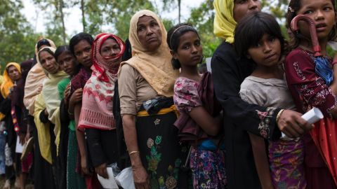 WHAIKHYANG, BANGLADESH - SEPTEMBER 10:  Rohingya refugee women queue for food rations after arriving from Myanmar on September 10, 2017 in Whaikhyang, Bangladesh. Recent reports have suggested that around 290,000 Rohingya have now fled Myanmar after violence erupted in Rakhine state. The 'Muslim insurgents of the Arakan Rohingya Salvation Army' have issued statement that indicates that they are to observe a cease fire, and have asked the Myanmar government to reciprocate.  (Photo by Dan Kitwood/Getty Images)