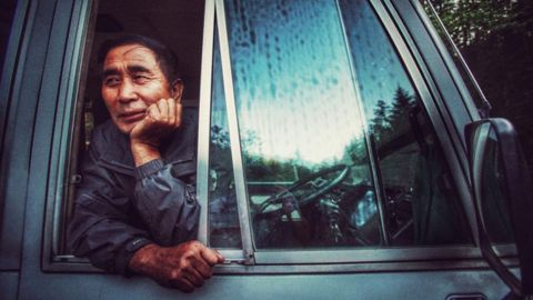 A bus driver who drives a Japanese vehicle over some of the bumpiest roads in North Korea. Taken on September 5.