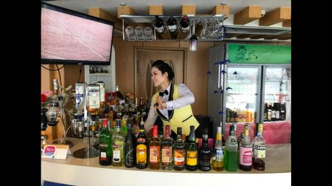 Bartender at the Rainbow floating restaurant in Pyongyang on September 10.