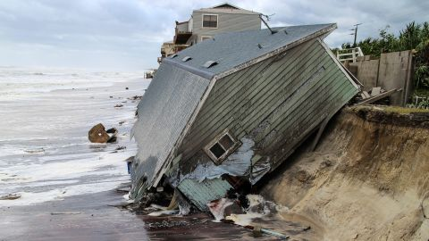 In the aftermath of Hurricane Irma, a house slides into the Atlantic Ocean in Ponte Vedra Beach, Florida, on Monday, September 11.