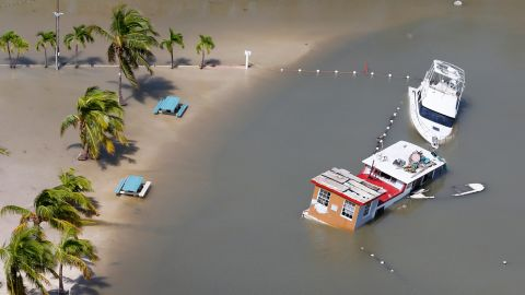Boats are partially submerged in Key Largo, Florida, on September 11.