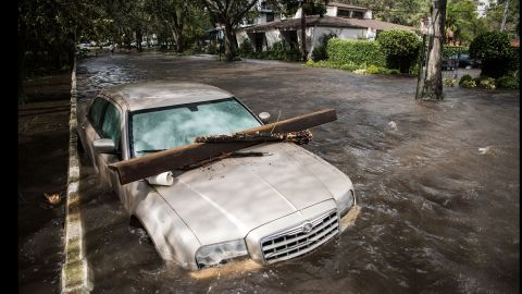 A vehicle is inundated by storm surge flood waters in Jacksonville, Florida, on September 11.