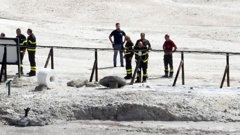 The coffin of  three people died in the crater stand under the green cloth at Pozzuoli, Naples, Italy, 12 settembre 2017. A couple and an 11-year-old boy have died at the Solfatara volcanic crater at Pozzuoli, near Naples, police said on Tuesday. Another child, aged seven, survived, the sources said. The woman was 42 and the man was 45.