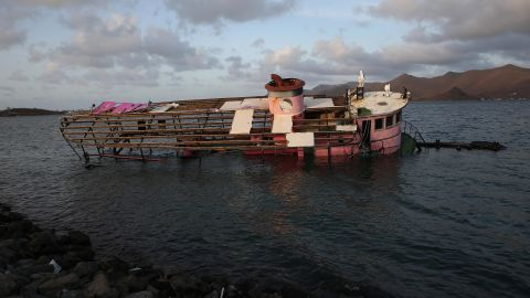 The skeleton of a boat drifts in St. Martin's Simpson Bay on September 11.
