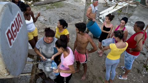 Cubans affected by Hurricane Irma line up to collect drinking water in Isabela de Sagua, Cuba, on Monday, September 11.