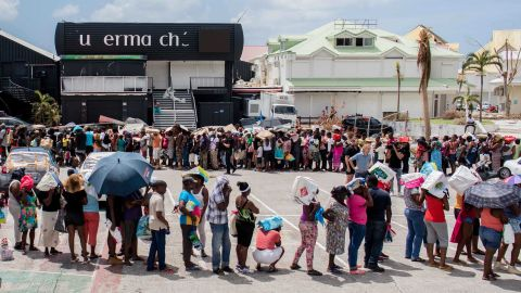 People line up for supplies in St. Martin on September 11.