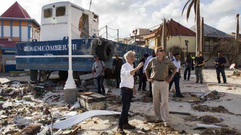 Dutch King Willem-Alexander, front right, tours damage in St. Maarten on September 11.