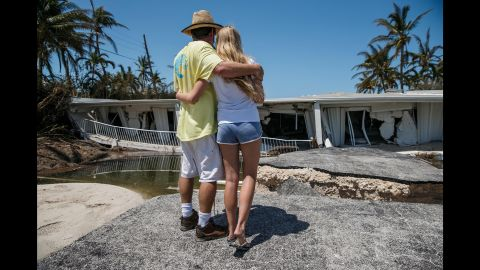 Mike Gilbert and his daughter Brooke embrace in front of a relative's destroyed condominium building in the Florida Keys on September 12.