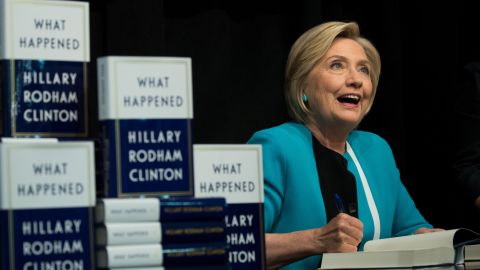 """NEW YORK, NY: Former U.S. Secretary of State Hillary Clinton signs copies of her new book """"What Happened"""" during a book signing event at Barnes and Noble bookstore September 12, 2017 in New York City. Clinton's book, which focuses on her 2016 election loss to President Donald Trump, goes on sale today. (Drew Angerer/Getty Images)"""
