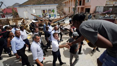 French President Emmanuel Macron shakes hands with St. Martin residents during a visit to the island on September 12.