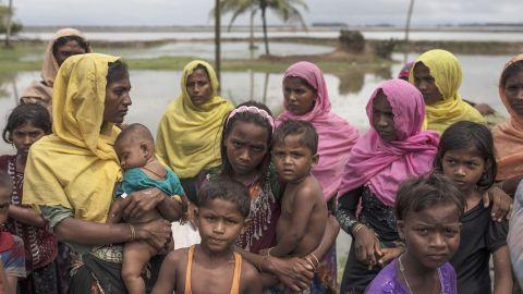 Refugees gather on the shoreline after arriving September 8, in Dakhinpara.
