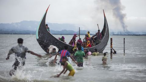 A boat full of Rohingya refugees arrives on September 9, on the Bangladeshi side of the Naf River.