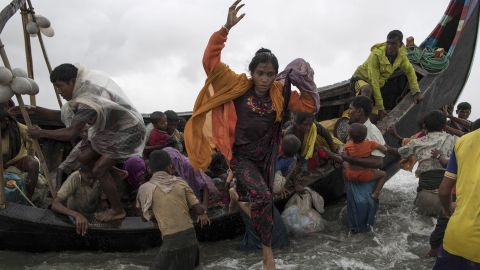 Refugees jump from the boat in Dakhinpara on September 12.