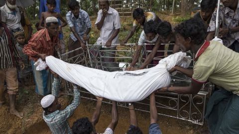 Rohingya refugees bury Nur Ali in Kutupalong, Bangladesh, on September 13. Ali was a 50-year-old man who died of gunshot wounds he sustained while fleeing violence in Myanmar.