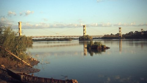 """This French-built suspension bridge was a popular pedestrian crossing and vantage point for its views of the Euphrates River. It became a key supply line in a battle for the city, and <a href=""""http://www.syriadeeply.org/articles/2013/11/2595/crossing-bridge-death-deir-ezzor/"""" target=""""_blank"""" target=""""_blank"""">collapsed under shelling.</a> Deir Ez-zor's Siyasiyeh Bridge was also destroyed."""