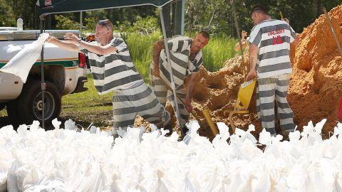 Lake County jail inmates fill sandbags in Astor, Florida, on September 13.