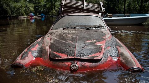 A classic Volkswagen sits in floodwaters September 13 in Middleburg, Florida.  Flooding from the Black Creek topped the previous high-water mark by about 7 feet.