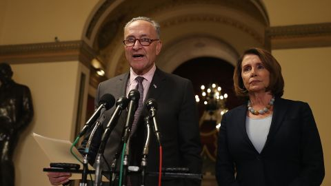 WASHINGTON, DC - MARCH 13:  Senate Minority Leader Charles Schumer (L) (D-NY) speaks as House Minority Leader Nancy Pelosi (D-CA) looks on during a news conference at the U.S. Capitol on March 13, 2017 in Washington, DC.